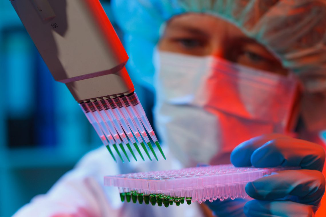 woman assistant in laboratory researching stem cells